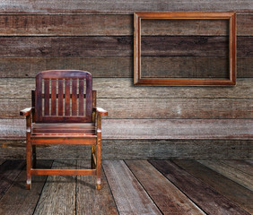 Picture frame and wood chair in wood room.