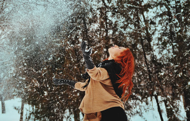 Young woman enjoys the snow