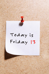 Paper with text Today is Friday 13 on beige background