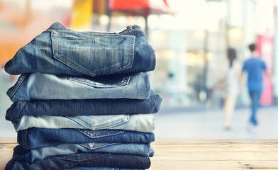 jeans in shop on wooden and shopping store background