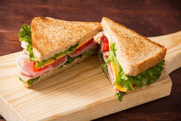 Sandwich bread tomato, lettuce, onion and yellow cheese