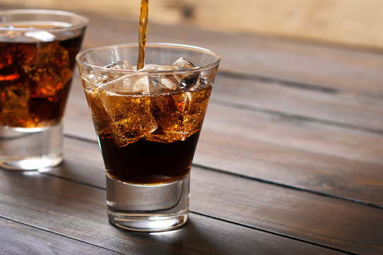 In a glass of whiskey and cola poured cola