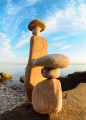 Figurines of stones on coast