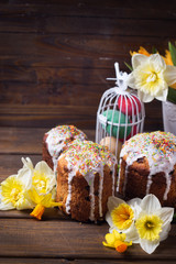 Easter cakes, flowers and Easter eggs  on  dark wooden backgrou