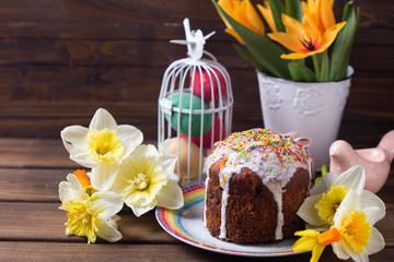 Colorful Easter cake, flowers and Easter decorations  on  dark w