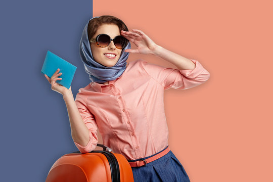 Fashion woman in sunglasses and scarf.