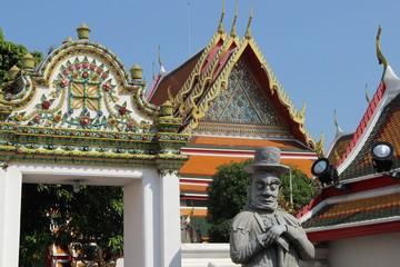 Chedi und Torwächter im Wat Pho, Bangkok, Thailand