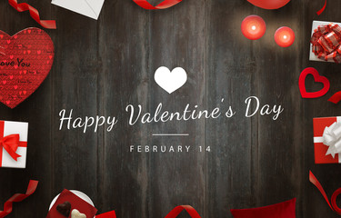 Happy Valentines Day scene with gifts, hearts, decorations on wooden table.