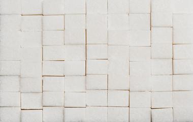 white lump sugar in cubes texture background