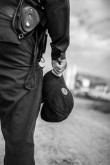 Detail of a police officer. Selective focus with shallow depth of field. Black and white toning.