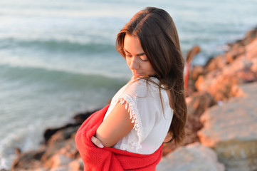 Portrait of beautiful woman in white dress at the sea beach