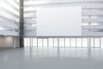 Blank white billboard in the hall of empty building with concret