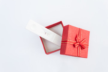 pregnancy in red gift boxes on white background