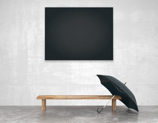 Blank black picture above wooden bench with black umbrella in em