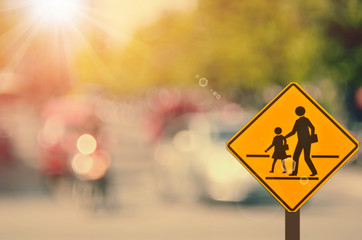 School sign on blur traffic road abstract background.