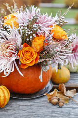 Bouquet of flowers in pumpkin
