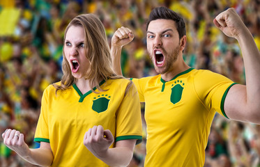 Brazilian couple fan celebrating in the stadium