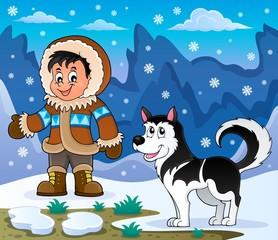 Inuit boy with Husky dog