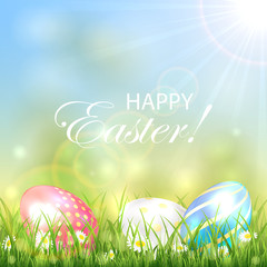 Easter background with three colorful eggs