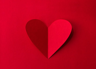 Paper heart on red background