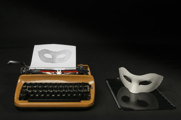 The picture of a carnival mask created from the letters on an old typewriter