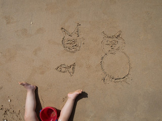 infant drawings on sand