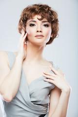 Fashion woman model posing in snapshot style at studio