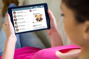 Composite image of woman using tablet at home