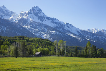 Horse ranch barn below the Grand Teton mountains of Wyoming