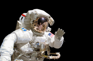 Close up of an astronaut isolated on black background - elements of this image are provided by NASA