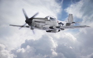 World War II era fighter flies among clouds and blue sky