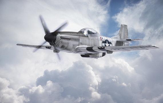World War II era fighter flies among clouds and blue sky
