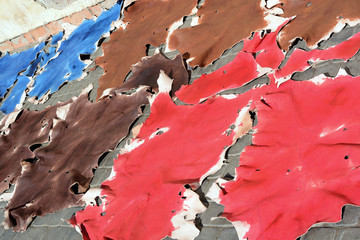 Marrakech, Morocco - January 1, 2016: raw freshly colored animal skins for drying in the sun