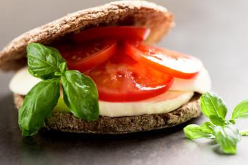Sandwich with mozzarella tomatoes and rye bread