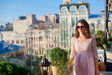 beautiful woman in glasses on a background of the city