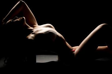 Woman in bikini body highlighted lay back arm up