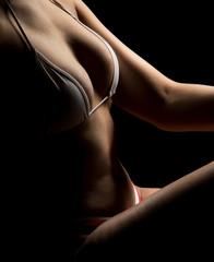Woman in white bikini highlighted body close