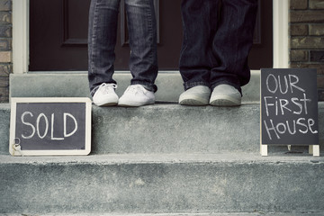 couple on doorstep of new home