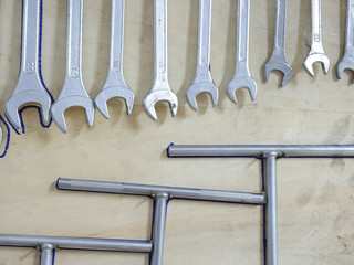Hand tools set hanging on the wooden board