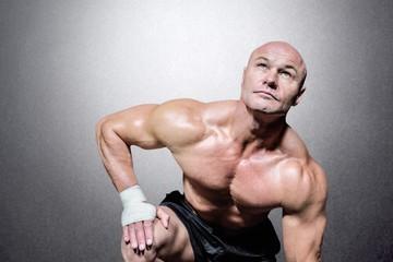 Composite image of bodybuilder exercising