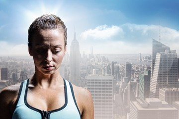 Composite image of sad athlete woman in sportswear