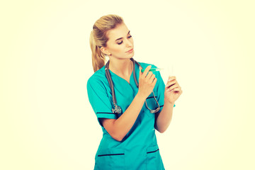 Female nurse or doctor preparing an injection