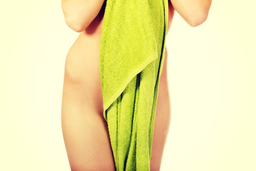 Sexy female body in green towel