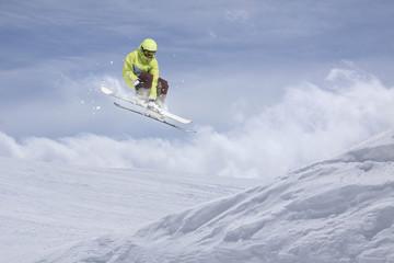 Flying skier on mountains. Extreme ski sport.
