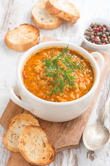 tomato soup with rice, vegetables and bread, vertical