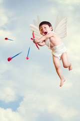 asian boy cupid with a bow and arrows  fly in the sky