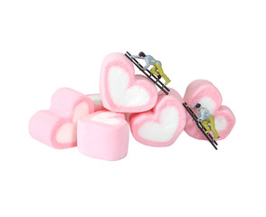 Miniature people working with sweet marshmallow candies ,selecti