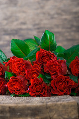 red roses on wooden board