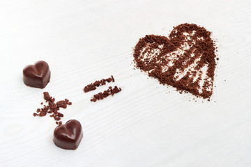Love formula concept. Two chocolate candies make big love for chocolate.