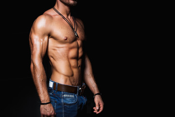 Muscular and sexy torso of young man in jeans Fototapete